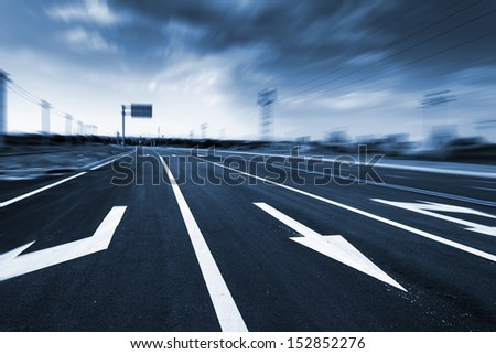 highway in steppe against a blue sky,long road stretching out into the distance - stock photo