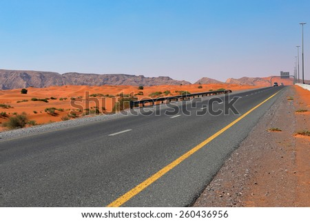 highway in the Arabian desert in Dubai - stock photo