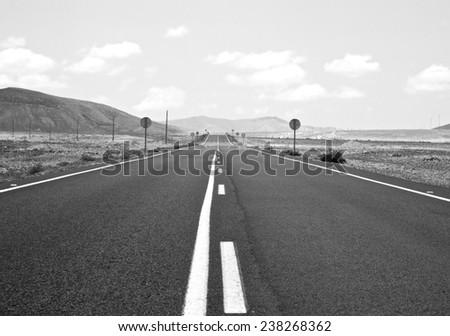 HIGHWAY IN THE DESERT - stock photo
