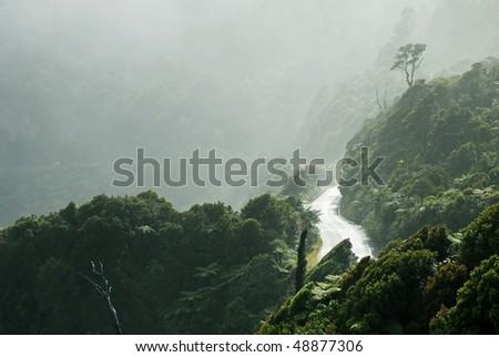 Highway in the morning mist - stock photo
