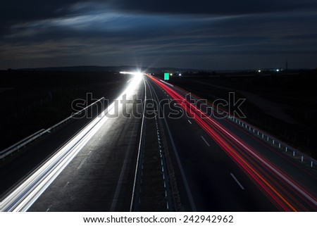Highway long exposure light trails in a cold night - stock photo
