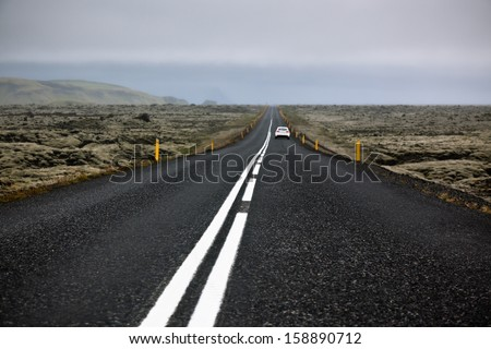 Highway N1 through Iceland landscape at foggy day. Filtered image - stock photo