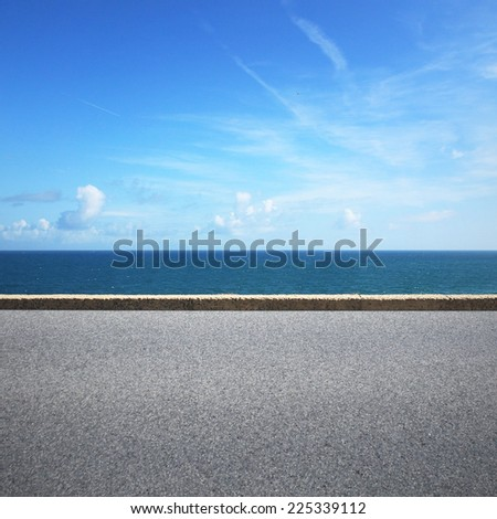 Highway on sunny summer day near the water - stock photo