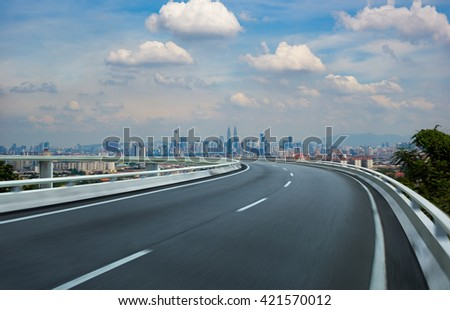 Highway overpass motion blur with city background . - stock photo