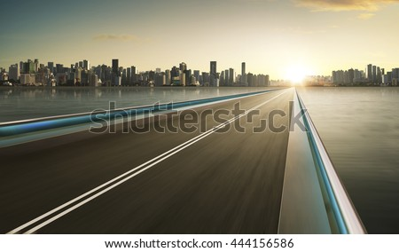 Highway overpass motion blur with city skyline background . warm mood . - stock photo