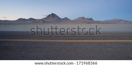 Highway Passes Great Bonneville Salt Flats Silver Island Mountains - stock photo