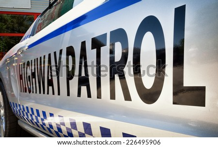 highway patrol text at a car - stock photo