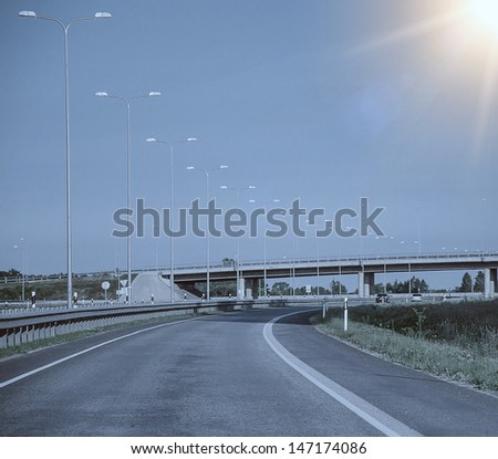 Highway perspective on a sky background - stock photo