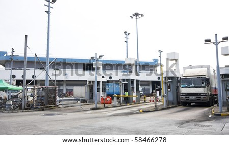 Highway road to toll in Hong Kong - stock photo