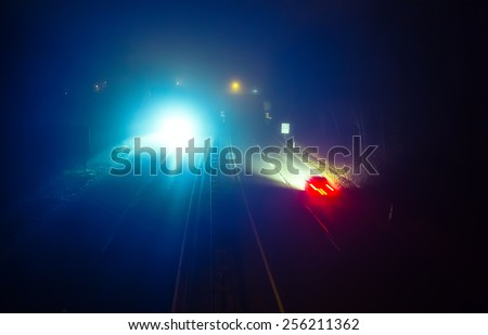 Highway road with traffic at night in fog (toned, diffused) - stock photo