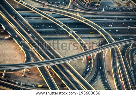 Highway roads with traffic in a big city viewed from the sky in evening - stock photo