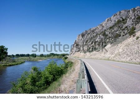 Highway 287 runs beside the Jefferson River in Montana. - stock photo