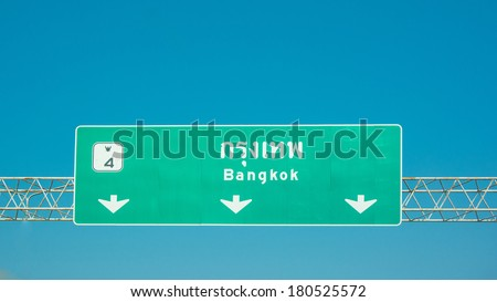 highway sign go to Bangkok on cloudy sky - stock photo