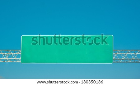 highway sign on cloudy sky - stock photo