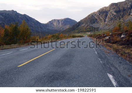 Highway through mountain landscape in autumn colours - Norway