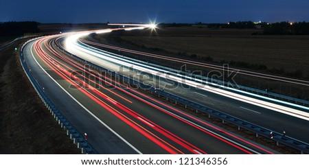 Highway traffic at night - stock photo