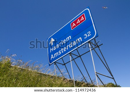 Highway traffic sign with aircraft in the air - stock photo