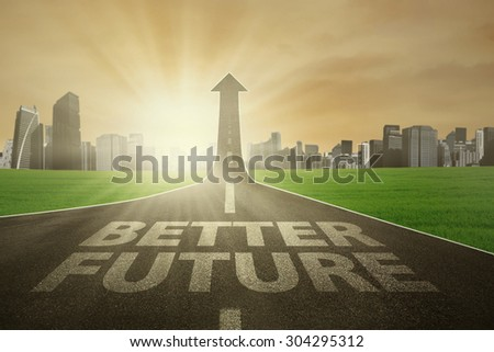 Highway with Better Future text rising upward in the morning, symbolizing the way to the better future - stock photo