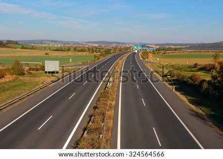 Highway with four lanes. Transportation concept. - stock photo