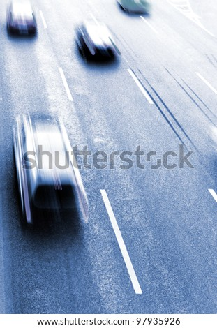Highway with lots of cars. Blue tint, high contrast and motion blur to rise speed. - stock photo
