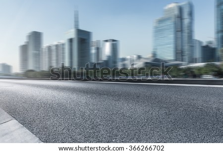 highway with modern building background, usa. - stock photo