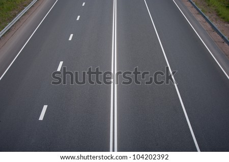 highway with white road markings - stock photo