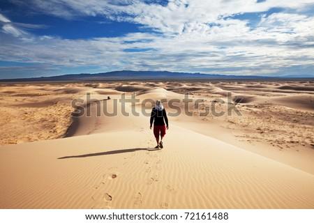 Hike in Gobi desert - stock photo