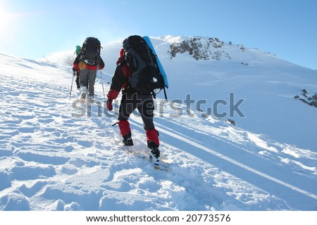 Hike in winter mountain - stock photo