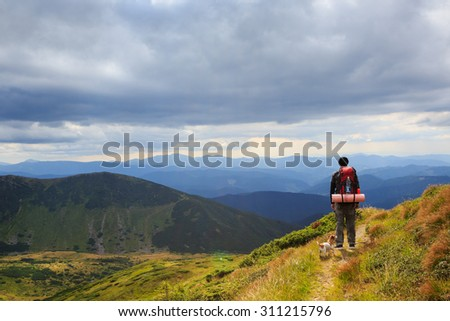 Hike journey lonely man on the mountain trails. Alone with the beautiful nature. Back to basics.Dramatic cloudy sky. Series of photos - stock photo
