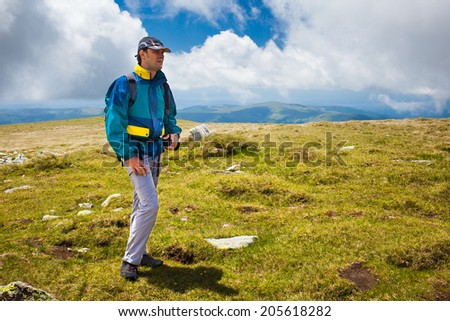 Hiker alone in Romanian Carpathians, Parang mountains - stock photo