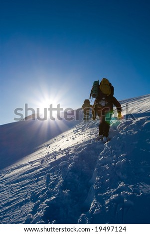 Hiker are in winter in mountains - stock photo