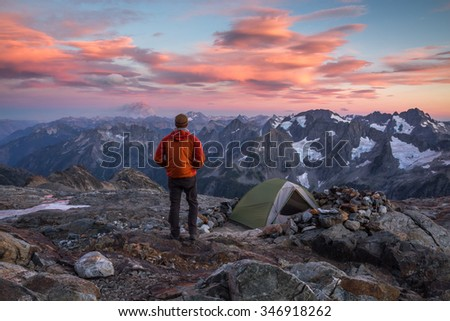 Hiker at sunset in North Cascades National Park - stock photo