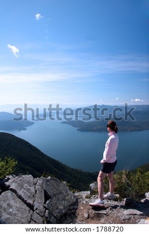Hiker at the top - stock photo