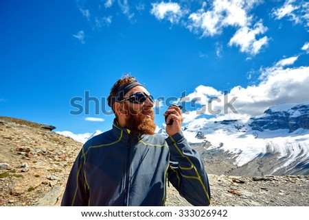 hiker at the top of a pass with radio enjoy sunny day in Alps. Switzerland, Trek near Matterhorn mount.