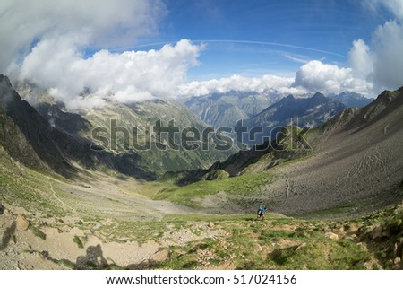 Hiker climbing in the Mountains of  National Park of Ecrins, Alps, France