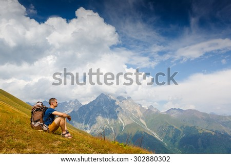hiker enjoy sunny day in summer mountains - stock photo