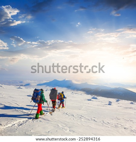 hiker group in a winter mountains - stock photo