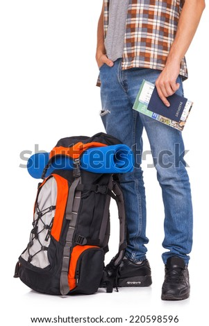 Hiker holding passport and tickets - stock photo