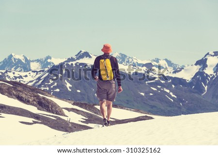 Hiker in Exit Glacier, Kenai Fjords National Park, Seward, Alaska - stock photo