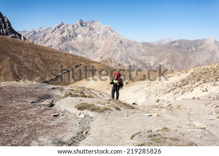 Hiker in Fann mountains, central asia, Tajikistan.