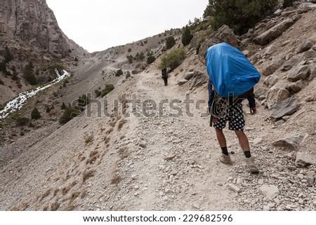 Hiker in Fann mountains, central asia, Tajikistan. - stock photo