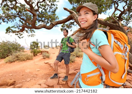 Hiker in Grand Canyon. Hiking woman and man resting enjoying hike and view on South Kaibab Trail, south rim of Grand Canyon, Arizona, USA. - stock photo