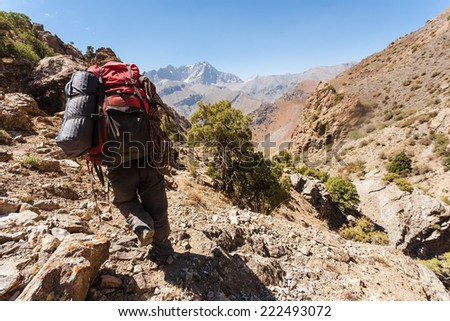 Hiker in high mountains, central asia, Tajikistan. - stock photo