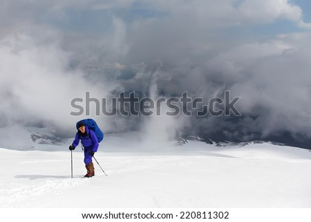 hiker in the mountain. Climb to the top. mountaineering - stock photo