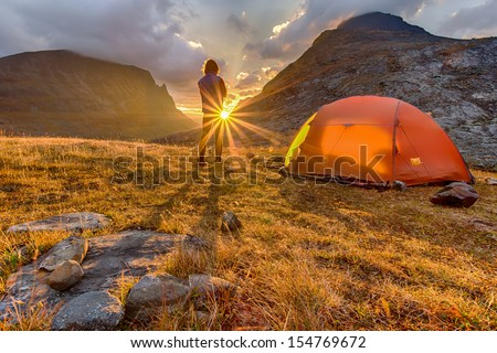 Hiker in the Sunrise with Tent
