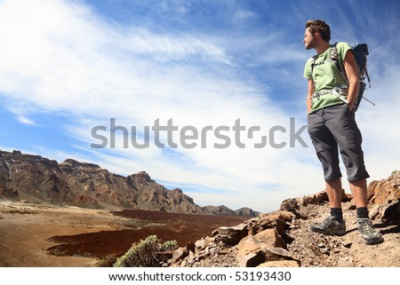 Hiker looking at view / copyspace during a hiking trip in beautiful volcano landscape on Teide, Tenerife. - stock photo