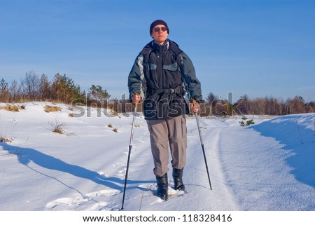 hiker on a winter road in a snow