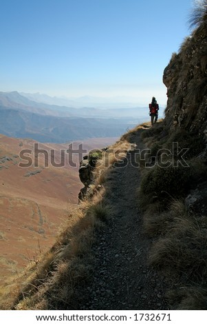 Hiker on footpath - stock photo
