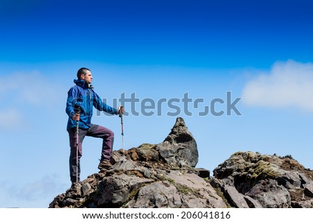 hiker on the rocky mountains  - stock photo