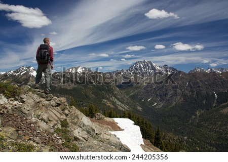 Hiker on the summit of Koppen Mountain. Cascade Mountains, WA.
